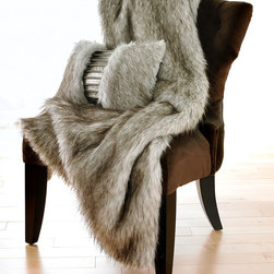 "Fox Siberian Throw - 48"" x 80"" Faux Fur - Let the winter winds howl, let the silver-iced night eclipse the sun, a welcome warmth is yours with the Fox Siberian Faux Fur Throw. Generously sized and luxuriously plush, the throw boasts a natural coloration of snow tipped in black. Placed upon a settee, chaise, or daybed, the throw invites an afternoon or evening of nestled repose. 48"" x 80"""