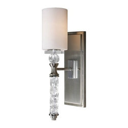 Uttermost 22486 Campania Wall Sconce - 5.25W in. Brushed Nickel Plated - About Uttermost The mission of the Uttermost Company is simple: to make great home accessories at reasonable prices. This has been their objective since founding their family-owned business over 30 years ago. Uttermost manufactures mirrors, art, metal wall art, lamps, accessories, clocks, and lighting fixtures in its Rocky Mount, Virginia, factories. They provide quality furnishings throughout the world from their state-of-the-art distribution center located on the West Coast of the United States.