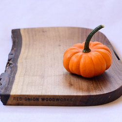 Black Walnut Cheese Board, Natural Edge by Red Onion Woodworks - A really good serving board makes even the simplest spread look grand. This one stands out because it is made from salvaged wood and features a stunning natural edge.