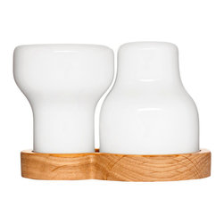 Contemporary Salt & Pepper Set - Every meal is twice as nice when you add spice. This salt and pepper set adds a piquant touch to your dining room setting, and would work quite nicely as a centerpiece. Produced in stoneware, these shakers know they're expected guests at every table. That's why they're so handsomely dressed.