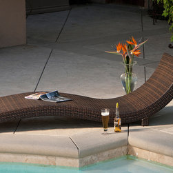 None - Outdoor Wicker Lounge - Perfect for patio or poolside relaxation,this curved wicker lounge offers streamlined styling and an ergonomic shape to enhance comfort. Crafted of weather-resistant wicker,it has a lightweight,sturdy frame and offers years of stylish service.