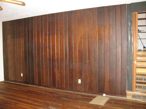need ideas for a dark wood paneled wall in living room