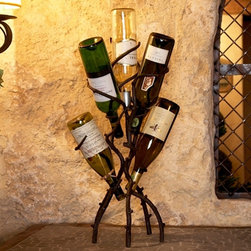 Wine Tree - This wrought iron wine tree offers an ideal way to attractively display six of your favorite wine bottles without taking up a lot of space. Hand forged to look like vines, this wine tree is beautiful sitting on your bar or table top and is a perfect match for almost any decor.