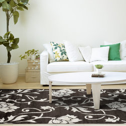 Alexander Home - Jullian Expresso Shag Rug (7'7 x 7'7) - Add style to your living room by adding this bold brown shag rug,which consists of a thick and comfortable one-inch pile. This Julian rug uses an ivory floral pattern to accent the lush brown shade. Add a non-skid pad to keep the rug secure.