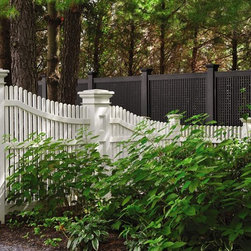 Fence and outside structures near the coast - Sloping Chestnut Hill picket fence with paneled lantern post as end post.
