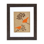 Fiber and Water - Autumn Birds Art - Two graphic orange birds pop vibrantly against a neutral background of brown branches and natural burlap. Like the flash of a wing or the call of a songbird, this contemporary yet earthy print brings an uplifting splash of nature to your surroundings. It comes ready to hang in a distressed black wood frame and contrasting white matte.