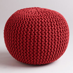World Market - Chili Pepper Knitted Pouf - Our Chili Pepper Knitted Pouf is a great alternative for extra seating in your home. To make each pouf, skilled artisans in India expertly knit richly dyed yarn around an ultra-plush cotton filling. The result is a sturdy yet incredibly comfortable place to sit for you and your guests that won't take up a lot of space, or a lot of your budget. In a convenient size, they're a great option for apartments, family rooms, and kids' rooms.