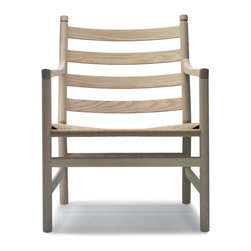 Carl Hansen & Son - Wegner CH44 Easy Chair Oiled Oak / Natural Seat, by Carl Hansen - Danish modern master Hans J. Wegner designed this chair back in 1965 and there's simply no improving on its clean, casual style and relaxing comfort. Made of oak with a natural finish and woven seat, its perfect for your favorite laid-back setting — the easiest easy chair ever.