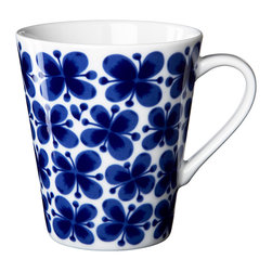 iittala Mon Amie Mug 11.5oz - Mon Amie (French for 'my friend') made its debut back in the 1950s, when Marianne Westman created the now classic decorative pattern one rainy Midsummer Eve. Over the years the blue floral decoration has become something of an icon for Rorstrand. Marianne was a true pioneer within her genre and has even been called 'the mother of Swedish porcelain'.