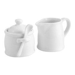 Stoneware Sugar and Creamer - Shiny white porcelain cream and sugar vessels make morning coffee hour stylish again.