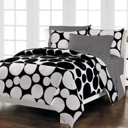 None - Spot the Dot 7-piece Bed in a Bag with Sheet Set - The comforter of this bedding set features features huge black dots on a white background while the bottom third is highlighted by a positive/negative effect. The set includes matching sheets and shams.
