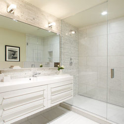 Manhattan Luxury Bathrooms | Chelsea Condo New Contemporary Bath | CItizenNYC.co - Zuma tubs, Duravit toilets, Dornbracht faucets, and showers with infinity drains. Bathrooms are tiled in marble, glass, or ceramic, and feature floors and tub and shower walls of marble or smoke-waxed limestone.