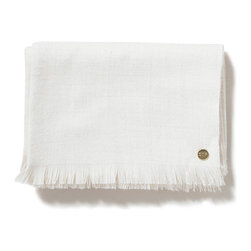 "Baby Alpaca Throw, Creme - This 100% baby alpaca woven throw is 50"" x 70"", with an additional inch on each end of the length for the delicate eyelash fringe. The piece is adorned with our signature gold St. Frank plate. Each blanket is packaged in an embossed gift box. Dry clean only."