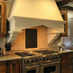 Gray Stone Kitchen Hood - This natural stone kitchen hood adds elegance and warmth to the heart of the home, the kitchen. This range hood can be ordered in other natural limestone, cantera, pinon, and adoquin stones. Each kitchen hood is hand carved and fabricated to fit our client's dimensions. We can work with you to design decorative carving on the hood to fit your style.
