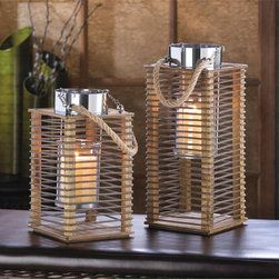 Arusha Rope and Bottle Design Tall Candle Lantern - this lantern blends old and new with the perfect mix of wire and wood accented by polished metal and a rope loop. The interior glass candle holder is supported by a removable metal frame for easy lighting and candle replacement.
