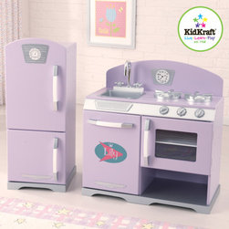"KidKraft - Pink Retro Kitchen & Refrigerator - With the Retro Kitchen, kids can cook up feasts for the whole family. The young chefs in your life are sure to love this wooden kitchens bright colors and adorable details. Solidly constructed with quality in mind, the Retro Kitchen makes the perfect gift and is large enough so that multiple children can play with it at once. The Kidkraft Retro Kitchen will provide hours of fun and educational entertainment and because of its classic design, still look great in any room in the house. Features: -Refrigerator, freezer, oven and dishwasher all open and close -Knobs on dishwasher, oven and sink turn -Removable sink for easy cleanup -Made of wooden products -Sturdy construction Dimensions: -Stove: 25.87""Lx13.75""Wx26.25""H -Fridge: 12.37Lx14Wx30.75H"