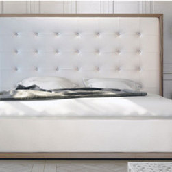 "Modloft - Ludlow Platform Bed - The Japanese-inspired Worth platform bed features a low profile hardwood frame An upholstered bonded leather headboard compliments this lavish feng shui bed. Mattress sits snuggly on a pine-slat mattress support system. Platform height measures 7 inches (2 inch inset). Mattress not included. Features: -Low profile hardwood frame.-Upholstered bonded leather headboard.-Bed Design: Platform.-Boxspring Required: No.-Tufted: Yes.-Distressed: No.-Includes bed.-Collection: Ludlow.-Distressed: No.-Collection: Ludlow.Dimensions: -Assembled Weight: 328-387 lbs.-Queen dimensions: 77"" W x 90"" D x 61"" H.-King dimensions: 93"" W x 90"" D x 61"" XH.-California King dimensions: 87"" W x 94"" D x 61"" H.-Overall Product Weight: 328-387 lbs.Warranty: -Manufacturer provides 1 year warranty."