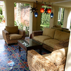 Outdoor Project 3 - A cozy nook in a gorgeous Mediterranean garden. Moroccan Lanterns, Rattan Furniture and an Iron Jali Coffee Table from Mix Furniture transform this space into a global-inspired retreat.