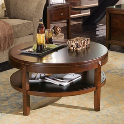 "American Drew - American Drew Tribecca Round Coffee Table Multicolor - 912-913 - Shop for Tables from Hayneedle.com! Wet your coffee table whistle with the sarsaparilla-chic American Drew Tribecca Round Coffee Table. Yes it's got a root beer finish durable construction and a display shelf pardner. About American DrewFounded in 1927 American Drew is a well-established leading manufacturer of medium- to upper-medium-priced bedroom dining room and occasional furniture. American Drew's product collections cover a broad variety of style categories including traditional transitional and contemporary. Their collections range from the legendary 18th-century traditional ""Cherry Grove "" celebrating its 42nd year of success to the extremely popular ""Bob Mackie Home Collection "" influenced by the world-renowned fashion designer Bob Mackie. ""Jessica McClintock Home"" features another beloved designer bringing unique style to an American Drew line. American Drew's headquarters are located in Greensboro N.C. Their products are distributed through thousands of independently owned retailers throughout the United States and Canada and around the world."
