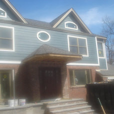Traditional Exterior by CM Windows & Doors