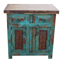 Distressed Wood Vanity, Turquoise - A beautiful distressed turquoise vanity, crafted from 100% solid wood. The doors have oxidized, rustic metal panels which match the handmade hardware. The top has been sealed to protect the vanity from any water damage. The piece is finished with a hand rubbed paste wax which provides a protective finish.