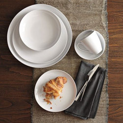 Organic Shaped Dinnerware Set - These organic dishes by West Elm are my everyday set. I find that modern-day dinner plates are way too big, so I didn't bother buying any. I use the 8-inch salad plates for everything.