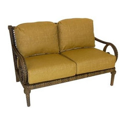 Woodard - Woodard South Shore Wicker Loveseat - The name Woodard Furniture has been synonymous with fine outdoor and patio furniture since the 1930s continuing the company�s furniture craftsmanship dating back over 140 years. Woodard began producing hand-made wrought iron furniture which led the company into cast and tubular aluminum furniture production over the years.� Most recently Woodard patio furniture launched its entry into the all-weather wicker furniture market with All Seasons which is expertly crafted and woven using synthetic wicker supported by an aluminum frame.� The company is widely known for durable beautiful designs that provide attractive and comfortable outdoor living environments.� Its hand-crafted technique used to create the intricate design patterns on its wrought iron furniture have been handed down from generation to generation -- a hallmark of quality unmatched in the furniture industry today. With deep seating slings and metal seating options in a variety of styles Woodard Furniture offers the designs you want with the quality you expect.  Woodard aluminum furniture is distinguished by the purest aluminum used in the manufacturing process resulting in an extremely strong durable product which still can be formed into flowing shapes and forms.� The company prides itself on the fusion of durability and beauty in its aluminum furniture offerings. Finishes on Woodard outdoor furniture items are attuned to traditional and modern design sensibilities. Nineteen standard frame finishes and nineteen premium finishes combined with more than 150 fabric options give consumers countless options to design their own dream outdoor space. Woodard is also the exclusive manufacturer of outdoor furnishings designed by Joe Ruggiero home decor TV personality.� The Ruggiero line includes wrought iron aluminum and all weather wicker designs possessing a modern aesthetic and fashion-forward styling inspired by traditional Woodard patio furniture designs. Rounding out Woodard�s offerings is a line of distinctive umbrellas umbrella bases and outdoor accessories.� These offerings are an integral part of creating a complete outdoor living environment and include outdoor lighting and wall mounted or free standing architectural elements � all made with Woodard�s unstinting attention to detail and all weather durability. Woodard outdoor furniture is an American company headquartered in Coppell Texas with a manufacturing facility in Owosso Michigan.� Its brands are known under the names of Woodard Woodard Landgrave and Woodard Lyon Shaw. With a variety of collections Woodard produces a wide array of collections that will be sure to suit any taste ranging from traditional to contemporary and add comfort and style to any outdoor living space. With designs materials and construction that far surpass the industry standards Woodard Patio Furniture creates beauty and durability that is unparalleled.  Features include Unique look of wicker furniture will add style and beauty to your outdoor setting Offered in wide variety of fabric options for cushions Super comfortable high quality cushions designed for extreme comfort Arm handles are offered for comfort and style Commercial Grade. Specifications Seat Height: 20 inches Fabric: 92W.