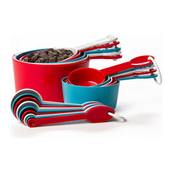 Progressive - Red & Blue Measuring Cup & Spoon Set - Instead of guesstimating how much flour to put in a one-third cup to make it about the same as a long-missing one-fourth cup, get this colorful measuring cup and spoon set and make the kitchen complete.   Includes 1/32-tsp., 1/16-tsp., 1/8-tsp., 1/4-tsp., 1/2-tsp., 1-tsp., 1/2-tbsp., 2-tsp. and 1-tbsp. measuring spoons and 1/8-cup, 1/4-cup, 1/3-cup, 1/2-cup, 2/3-cup, 3/4-cup, 1-cup, 1 1/2-cup, 1 3/4-cup and 2-cup measuring cups Polypropylene Dishwasher-safe Imported