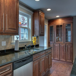 Chocolate color maple tall cabinets - Full line of Raised Panel kitchen Cabinets and Vanities with a large selection of Accessories finished in a Chocolate color