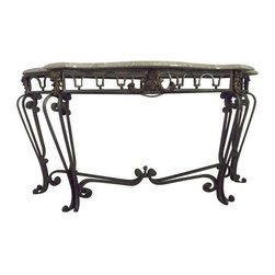 Used Marble And Metal Mediterranean Console Table - This dramatic piece adds flare to any room.  Wrought iron with a blue-green tinge is twisted into supports for a thick marble top. Brass accents in iron give the piece some traditional embellishment. A few superficial scratches can be found on the marble, but are unnoticeable unless you look for them. There is a small chip in the marble on the backside, but again it is not noticeable unless you know where to look. Fade away the scratches with some marble wax and set this baby up in your foyer for a hardy Mediterranean welcome.