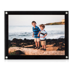 """Sleken - Medal Blocks - Premium Acrylic Block Picture Frame - 6"""" x 8"""" - Black - This is the black version of the Sleken (Medal Blocks) high quality picture frame.  This is for those who prefer not to have their picture take up the entire frame and want to leave plenty of space to act as a black border. This is not a 5"""" x 7"""" frame, it is a 6"""" x 8"""" x 1"""" frame that is an excellent fit for a 5"""" x 7"""" picture that leaves 1/2"""" black border on all sides of the picture to allow for the floating effect. No cropping required for this frame! Premium features that set Sleken frames apart from others include anti-scratch acrylic, which drastically improves the chances of unwanted blemishes. The beveled edges may seem minor, but really make the quality stand out. To top it off, these frames are packaged in a two piece gift box and microfiber bag. These features all contribute to very high quality frames and make great gifts."""
