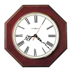 """Howard Miller - Octagon Shaped Wall Clock with Off-White Dial - A timeless classic, this octagon-shaped wall clock with an off-white dial and brass finished bezel can compliment any decor. Large Roman numerals make this an easy and pleasant clock to see hanging on your wall. Finished in Windsor Cherry on select hardwoods and veneers. Quartz, battery operated movement. * Octagon-shaped with an off-white dial and brass finished bezel. . Finished in Windsor Cherry on select hardwoods and veneers. . Quartz, battery operated movement. . D. 1-1/2"""" (4 cm). Dia. 11-1/2"""" (29 cm)"""