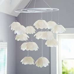 Capiz Blossom Mobile - I think this shell mobile would be an awesome neutral if you have colorful walls.