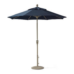 "Grandin Road - Octagonal Outdoor Market Umbrella - Classic, all-weather market umbrella. Canopy made from fade- and moisture-resistant, solution-dyed polyester. Single-vent canopy allows warm air to circulate. Powdercoated aluminum frame and pole included. Octagonal umbrella with an 8-rib canopy. Create your own custom Market Umbrella in just three easy steps: pick the perfect shape and size for your patio, select a canopy color or pattern, and specify a frame finish. Then add a matching cast iron base (sold separately) for unwavering support. Configure your favorite combination, and your season is sure to be made in the shade. . . . . . 1-1/2"" dia. pole. Raise, lower, and adjust your canopy with the integrated hand-crank lift and push-button tilt controls. Fluted base crafted from cast iron (sold separately); 50 lb. base recommended. Simple assembly required. Always close umbrella when not in use or in inclement weather. Imported."
