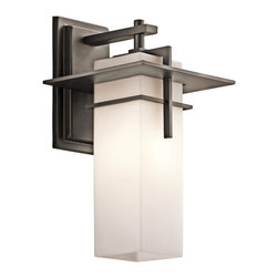 "Kichler - Contemporary Kichler Caterham 14 3/4"" Wide Outdoor Wall Light - This handsome outdoor wall light features a vertical rectangular shade of beautiful satin etched cased opal glass. A metal frame in warm Old Bronze finish surrounds the glass and attaches to a wall plate also in Old Bronze. A simple yet sophisticated outdoor fixture from Kichler Lighting. Satin etched cased opal glass. Olde Bronze finish metal. Takes one 100 watt bulb (not included). 8"" wide. 14 3/4"" high. Extends 9"". UL listed. Backplate is 4 3/4"" wide and 8"" high.  Satin etched cased opal glass.   Olde Bronze finish metal.  A Kichler outdoor wall light design.  Takes one 100 watt bulb (not included).   8"" wide.   14 3/4"" high.   Extends 9"".   UL listed.   Backplate is 4 3/4"" wide and 8"" high."