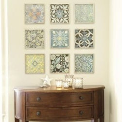 Red Patchwork Prints - These vintage patchwork prints are a perfect 10 in their set of nine. They can be hung side by side to look like a single piece of art or spaced apart (as shown) to fill a larger space. The color palette is soft and updated with yellows, pale blues and chocolate browns.