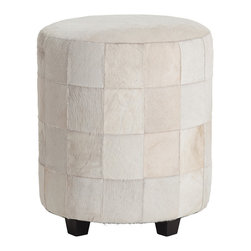 Wimberely Patchwork Leather Ottoman - Snow-white hide with sleek pale hair was pieced together to combine vintage-inspired patterning with the posh impression of subtle fur in the Wimberely Patchwork Leather Ottoman. A classic round stool with tapered block feet in an upscale ebony, this upholstered accent-seating piece provides monochrome looks that coordinate with your decor easily despite standout styling.