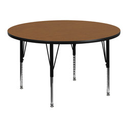 Flash Furniture - Flash Furniture 42 Inch Round Activity Table - Flash Furniture's Pre-School XU-A42-RND-OAK-T-P-GG warp resistant thermal fused laminate round activity table features a 1.125'' top  and a thermal fused laminate work surface. This round laminate activity table provides a durable work surface that is versatile enough for everything from computers to projects or group lessons. Sturdy steel legs adjust from 16.125'' - 25.125'' high and have a brilliant chrome finish. The 1.125'' thick particle board top  also incorporates a protective underside backing sheet to prevent moisture absorption and warping. T-mold edge banding provides a durable and attractive edging enhancement that is certain to withstand the rigors of any classroom environment. glides prevent wobbling and will keep your work surface level. This model is featured in a beautiful oak finish that will enhance the beauty of any school setting. [XU-A42-RND-OAK-T-P-GG]