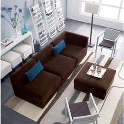 anchor chocolate corner chair - it's the conversation pits. Easy modular corner chair in a velvety chocolate poly on a thick comfy cushion and super-lo angled back. Put two together to create a loveseat. You can hang out low under the radar for the whole weekend and never leave. (Great asset: rubber-capped feet keep pieces in place on hardwood floors, and won't scratch.) Also in natural cotton-rayon.eco-friendly construction:- Certified sustainable, kiln-dried hardwood frame- Seat cushion is soy-based polyfoam- Made in USAfeatures:- 100% poly fabric: chocolate- Sinuous wire support and webbing- Removable feet have rubber bottom- Benchmade
