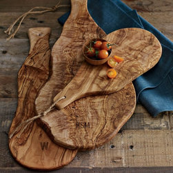 Olive Wood Paddle Boards - Mmm, a cheese course for the table served atop these rustic paddle boards would complement a Thanksgiving theme wonderfully. What a great year-round serving tray or gift!
