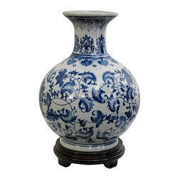 Oriental Unlimted - 9.5 in. Dia. Blue & White Floral Porcelain Va - Rosewood stand sold separately. A unique and distinctive Oriental style flower vase. A lovely decorative accent, as well as a beautiful gift idea. Fine quality Chinese porcelain vase with distinctive globe design. This item shot with the stand for illustration purposes, the stand is sold separately. Please select the 6 in. Dia. size of our Rosewood Pedestal Stand, Rosewood Carved Stand, or Rosewood Vase Stand.. 9.5 in. Dia. x 12 in. H (4 lbs.)