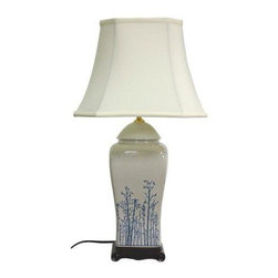 """Oriental Furniture - 26"""" Blue and White Spring Forest Porcelain Vase Lamp - Elegantly hand-crafted by artisans in China's Guangdong province, this beautiful piece combines a Song dynasty style porcelain vase with a carved wooden base. The porcelain part of the lamp features a textured glaze sure to add a colorful accent to any room. A fabric shade on a steel frame completes the design. This porcelain lamp features a three-way light fixture that uses up to a 100 watt bulb and includes a soft hand made shade."""