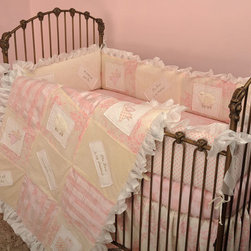 Cotton Tale Designs - Heaven Sent Girl 4 Piece Crib Bedding Set - A quality baby bedding set is essential in making your nursery warm and inviting. All Cotton Tale patterns are made using quality materials and are uniquely designed to create your perfect nursery. The Heaven Sent Girl Collection is a beautiful combination of Pinks and Cream. Touches of sheer cloud like fabrics and soft minky make this pattern irresistible. The quilt and bumper are appliqued with spiritual messages celebrating the joy of birth. Heaven Sent, A Perfect Gift from God, The Lord is my Sheppard, and I am Wonderfully Made, are the four embroidered blessings on white linen patches accompanied by sweet appliqued angels, sheep and wrapped gifts. The 4 sectional bumpers patch worked front and back. The sheet is 200 plus thread count and 100% cotton. The crib skirt is a shirred, fully lined, cream and pink floral, 16 inch drop. Matching accessories include crib blanket, standard ivory lamp base and shade, diaper stacker, hamper, musical mobile, fitted sheet, valance, pillow pack, toy bag, and hand painted wall art.