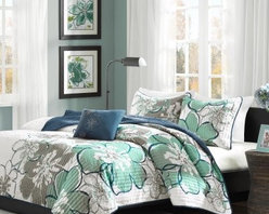 Mizone Allison Skylar Quilt Set - The Mizone Allison Skylar Quilt Set will decorate any dorm room or bedroom with ease. Its oversized floral pattern communicates a laid back style with muted blues, greens, and greys. Made of 100% polyester, you'll fall right to sleep under this stylish and cozy quilt. Its reversible design lets you quickly change the theme. It's available in a variety of sizes. This machine-washable bed set includes the quilt, one to two pillow shams (based on the size you choose), and a decorative pillow. Quilt Dimensions:Twin/twin XL: 68 x 90 in.Full/queen: 86 x 90 in.