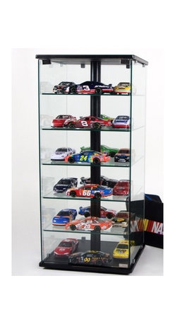 "Tier One Designs - Glass and Aluminum Display Case with Swivel - This contemporary glass and aluminum display case is a great addition to any home or office. The thick 6mm tempered clear glass shelves allow for ample display room for your collectibles. Unlike most cases that hide items with backing or solid wood construction, this case lets you swivel it to see each side and the see through design allows you to easily look from the front to back. Features: -Thick 6mm tempered clear glass -5 shelves for display -Swivels to see different angles -Carries a 1 year warranty against defects -Overall dimensions: 34"" H x 18"" W x 18"" D"