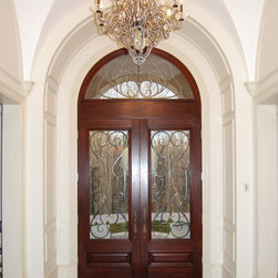 Entry Doors - Hand made mahogany entry system with custom iron work.