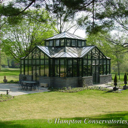 Greenhouse - An interesting example of a freestanding greenhouse manufactured out of aluminum.  The room is cruciform in shape with a central spiral staircase leading to a glass-floored balcony that over looks the grounds.