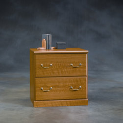 """Sauder - Orchard Hills Lateral File Cabinet with Hutch - American country style that provides endless versatility in the Orchard Hills Collection. Solid cases are softened by finely detailed moldings and brass-finished hardware, while warm Carolina Oak finish makes this piece the perfect accompaniment to the existing decor of any home. Features: -Lateral file cabinet. -Orchard hills collection. -Carolina oak finish. -Drawers with full extension slides hold letter legal or European size hanging files. -Made in USA. -Assembly required. -Manufacturer provides 5 year warranty. -Item not available with lock. -Overall dimensions: 30.25"""" H x 30.13"""" W x 20.88"""" D."""