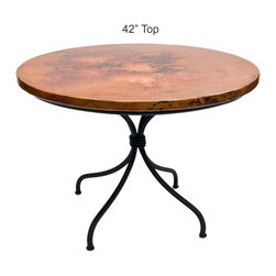 """Mathews & Company - Italia Dining Table with 42"""" Round Top - Delight family and friends with the pleasing lines and striking features of this classic dining table. The smooth, polished iron base perfectly sets off the bright tones and rich texture of the hand-fired copper. Four sturdy legs, wrapped and welded together at the center provide a steady base for the roomy table top. The patterns in each copper piece we fire are slightly different and all one-of-a-kind. With its lasting beauty and interest, you will never need to cover this table with a cloth, but can leave the craftsmanship of our artisans on full display. Pictured in Copper top and Black finish."""