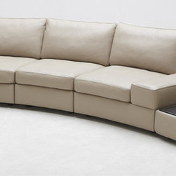 Zuri Furniture - Beige Palazzo Leather Sofa With Tables - Palazzo's unique curved shape, extendable seat depth, and optional seat and table additions will accommodate even the most particular tastes. This beautiful sofa is made with aniline dyed Italian Leather on seat and arms, with color match leatherette on the back. A kiln-dried hardwood frame gives it a solid feel supported by high density foam. Tables are composed of walnut veneer.